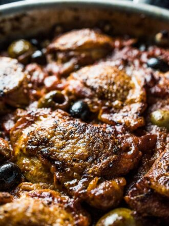 This is my favorite Italian Braised Chicken recipe. The chicken thighs are first seared until the skin is crispy then they're gently simmered in a delicious tomato and olive sauce. The chicken becomes super flavorful and tender. This is a healthy dinner recipe you don't want to miss.   paleo + gluten-free + Whole30 compliant  theendlessmeal.com   #italianchicken #chicken #chickenrecipes #healthyrecipes #whole30recipes #paleorecipes #glutenfreerecipes