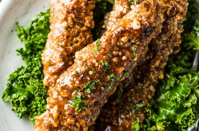 These sweet and sticky Paleo Honey Garlic Chicken Fingers are as good as they get. They're coated in a delicious almond flour crust then dunked in a honey garlic sauce.They're a quick and easy, healthy dinner recipe your whole family will LOVE! | theendlessmeal.com