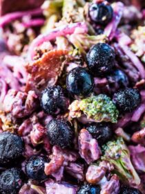 This deliciously Tangy Roasted Broccoli Salad is dotted with fresh or frozen blueberries, bacon, and pecans. It's the perfect healthy winter salad recipe. You will LOVE it! | theendlessmeal.com | #salad #saladrecipes #broccoli #broccolirecipes