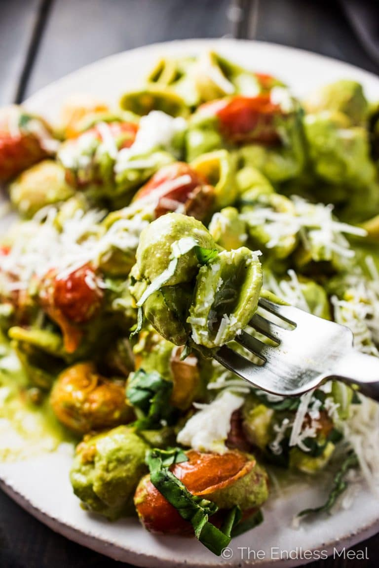 This super simple yet crazy delicious Caprese Pesto Pasta is as good as it gets. The lemony pesto is a creamy blender pesto that is so easy to make. Pour that over pasta and toss with some sauteed cherry tomatoes and mozzarella and dinner is served. It's the perfect Meatless Monday vegetarian supper recipe. | theendlessmeal.com