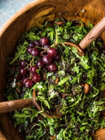This is the ultimate Wild Rice Salad. It's loaded with slightly peppery arugula and lots of grapes, toasted almonds, goat cheese, and fresh herbs. Then it's tossed in an easy to make tangy lemon poppy seed dressing. Serve it with a side of your favorite protein for an easy weeknight dinner or as part of a big weekend feast. Either way, you will LOVE it! | vegetarian + vegan adaptable | theendlessmeal.com | #salad #wildrice #vegetarian #easter #arugulasalad #wildricesalad