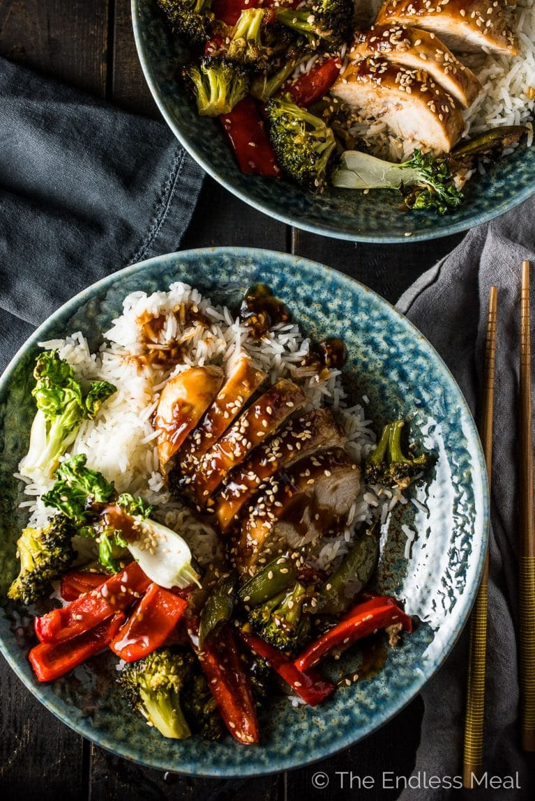 Easy healthy dinner recipe coming atcha! This super easy to make Asian Chicken Sheet Pan Dinner has all the flavors of your favorite stir-fry but cooks together on one pan in the oven. Serve it with a side of rice (or cauliflower rice!) for a simple and delicious weeknight meal.  | gluten-free + paleo | theendlessmeal.com | #sheetpanchicken #chicken #asianrecipes #healthyrecipes