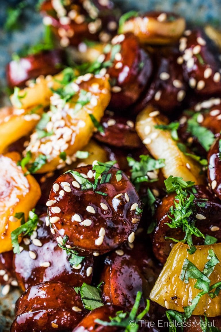 These super delicious Pineapple Sausage Bites are a simple and easy to make appetizer perfect for your party. Keep it simple and serve them in a bowl or get fancy and skewer them on toothpicks. Either way, your guests will LOVE these!   gluten-free + paleo   theendlessmeal.com   #sausagebites #sausage #appetizer #partyappetizer #glutenfree #paleo #grimms