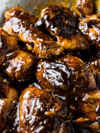Want some finger lickin' good sticky chicken? This Guinness Chicken has your name on it! Chicken thighs are first seared light brown then cooked in an easy to make sticky sauce made with your favorite Irish beer. It's my newest favorite chicken recipe! | theendlessmeal.com | #chickenrecipes #guinness #stickychicken #familyrecipes #gamedayrecipes #stpatricksdayrecipes #chicken