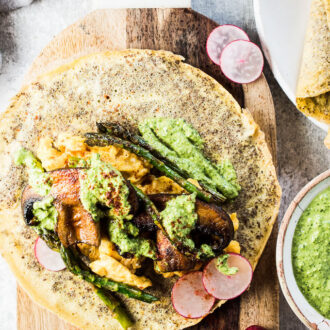 Who knew that healthy Mushroom Breakfast Tacos could be so delicious? Soft scrambled eggs, smoky portobello mushrooms, crisp asparagus, and pesto are all wrapped up in easy to make flax seed and egg tortillas. These pretty crepe like tacos make a great make-ahead brunch recipe or meal-prep for weekday mornings. You will LOVE them! | vegetarian + gluten-free + paleo + Whole30 approved | theendlessmeal.com | #vegetarian #breakfasttacos #tacos #whole30 #paleo #brunch
