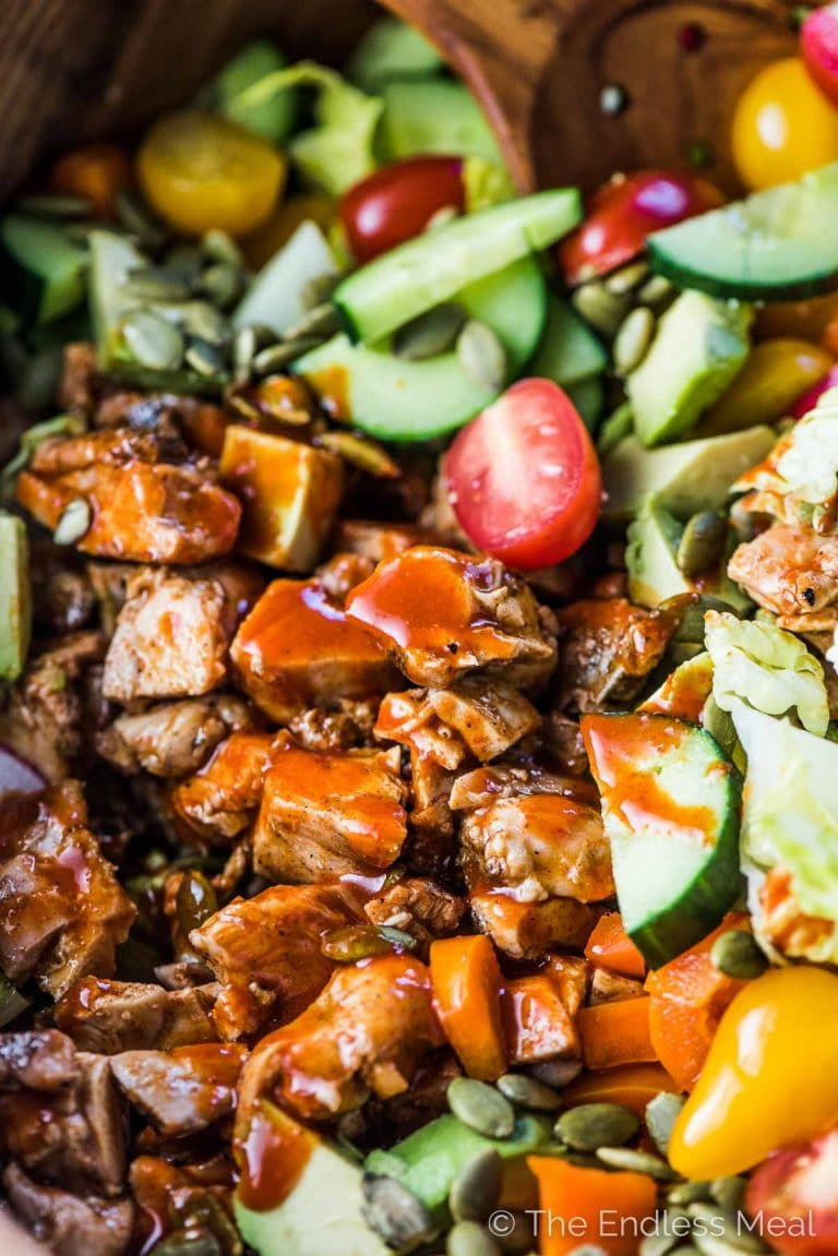 This delicious Buffalo Chicken Salad is loaded with crispy romaine hearts, spicy buffalo chicken, all your favorite veggies and tossed in a healthy and super tasty avocado ranch dressing. We like it as a hearty dinner salad but it's just as good as a part of a bigger BBQ meal. | gluten-free + paleo + Whole30 adaptable | #theendlessmeal #chicken #salad #buffalochicken #ranch #whole30 #paleo #glutenfree #healthyrecipes