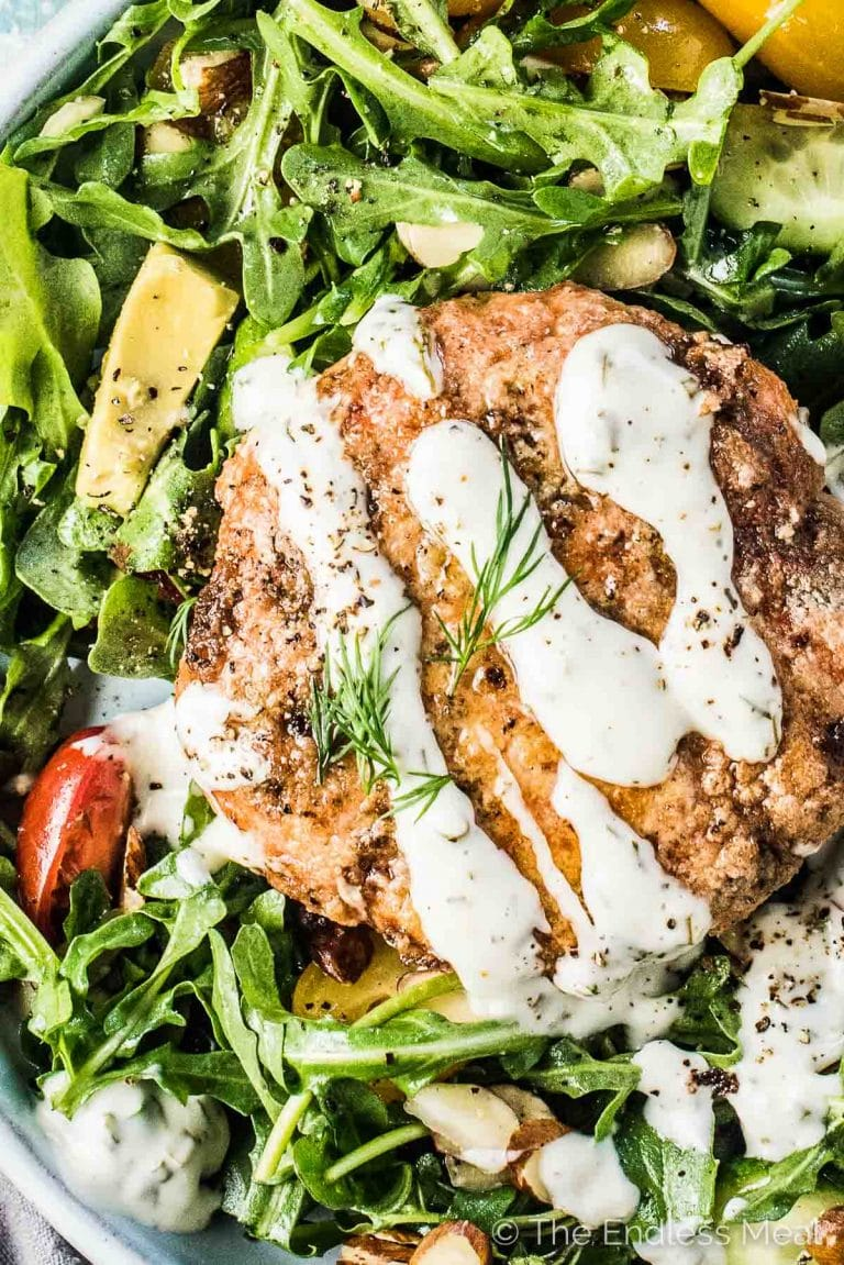 SAVE FOR LATER!   Lemony Salmon Burgers for a healthy, summer, dinnertime win! These healthy fish burgers are super easy to make and so tasty. I like to serve the salmon patties on top of a big salad, but they're just as good eaten in a bun with the lemon dill sauce dolloped on top.   gluten-free + paleo + Whole30 approved   #theendlessmeal #salmon #fish #salmonburgers #burgers #healthyrecipes #paleorecipes #whole30recipes #glutenfree #salmonpatties