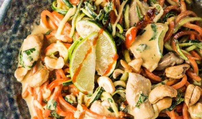 SAVE FOR LATER! Cashew Chicken Zoodles are a super easy to make and delicious weeknight dinner recipe. They're loaded with healthy and low carb veggie noodles smothered in a creamy cashew sauce that is totally addictive. This is our favorite chicken and zoodles recipe! | gluten-free + paleo + Whole30 adaptable | #theendlessmeal #zoodles #chicken #chickenzoodles #paleorecipes #whole30recipes #zucchininoodles #cashewbutter #cashews #carrotnoodles