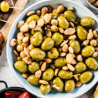 SAVE FOR LATER! Easy Marinated Olives and Almonds is a delicious, healthy, and super simple to make tapas recipe. Gently flavored with garlic and lemon, this appetizer will be a hit! | vegan + paleo + Whole30 | #theendlessmeal #olives #marinatedolives #almonds #tapas #appetizers #olievsfromspain #vegan #paleo #glutenfree #whole30