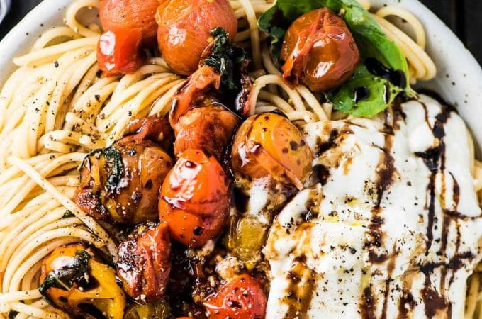 SAVE FOR LATER! Fresh Summer Spaghetti is quick to make and bursting with bright flavors. Cherry tomatoes are quickly sauteed with garlic and olive oil then tossed with a generous handful of basil. The pasta and sauce are tossed together then drizzled with some sweet balsamic vinegar. Summer pasta doesn't get better than this!   vegetarian + gluten-free + vegan adaptable   #theendlessmeal #pasta #spaghetti #summerpasta #summer #easypasta #dinnerrecipes #pastarecipes #vegan #vegetarian #glutenfree