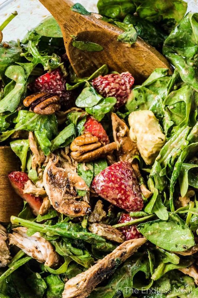 This easy to make and crazy delicious Grilled Chicken Salad is loaded with sweet summer strawberries, pecans, and creamy avocado. The tasty balsamic vinaigrette does double duty as the salad dressing and marinade for the chicken. Healthy summer salads never tasted so good! | gluten-free + paleo and Whole30 adaptable | #theendlessmeal #chicken #salad #chickensalad #grilled chicken #summer #spinachsalad #strawberries #glutenfree #whole30 #paleo #dinnersalad