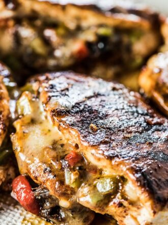 Cheesy Fajita Stuffed Chicken is the best we're eating right now. Chicken breastsare stuffed with peppers, onions, and spicy habanero jack cheese then rubbed with chili powder and grilled or pan-fried until juicy, cheesy, and delicious. | gluten-free + keto | #theendlessmeal #chicken #fajitas #chickenrecipes #southwest #mexican #grill #bbq #cheese #healthyrecipes