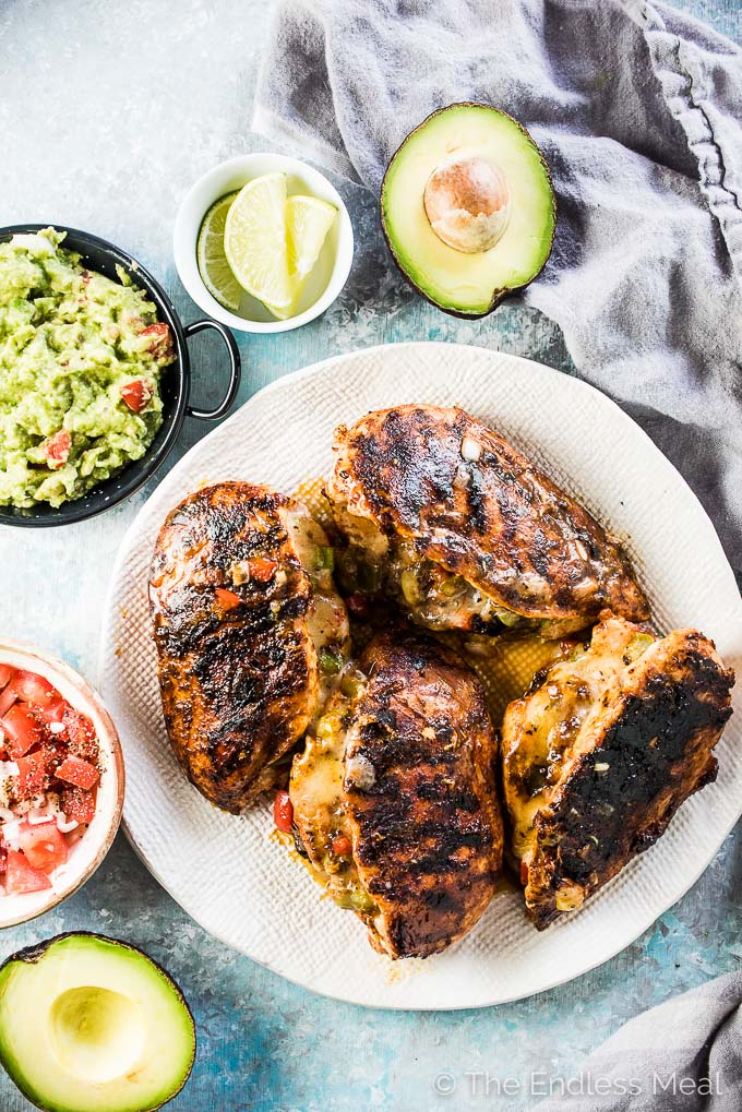 Cheesy Fajita Stuffed Chicken is the best we're eating right now. Chicken breasts are stuffed with peppers, onions, and spicy habanero jack cheese then rubbed with chili powder and grilled or pan-fried until juicy, cheesy, and delicious. | gluten-free + keto | #theendlessmeal #chicken #fajitas #chickenrecipes #southwest #mexican #grill #bbq #cheese #healthyrecipes