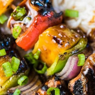 SAVE FOR LATER! Grilled Hawaiian Chicken Skewers are threaded with juicy marinated chicken, sweet pineapple, and crunchy peppers and onions. Once they're grilled to perfection they're drizzled with an easy to make (and refined sugar-free!) tasty teriyaki sauce and served with either coconut rice or healthy coconut cauli rice.  | paleo + gluten-free + refined sugar-free | #theendlessmeal #hawaiian #hawaiianchicken #chicken #chickenkebabs #chickenskewers #bbq #grill #grilledchicken #pineapple #pineapplechicken #teriyaki #paleo #refinedsugarfree #glutenfree