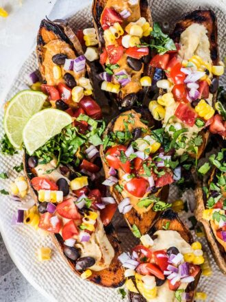 SAVE FOR LATER! Grilled Southwest Stuffed Sweet Potatoes with BBQ Hummus are a healthy and delicious summer recipe. They're hearty enough to be an easy to make vegan dinner recipe but also taste delicious as a side to whatever you've got on the grill! | gluten-free + vegan | #sweetpotatoes #southwest #bbqrecipes #southwestrecipes #veganrecipes #glutenfree #hummus #sabra