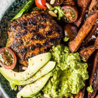 SAVE FOR LATER! Chili Chicken Burger Bowls are everything you love about burgers but served as a bowl. The chicken burger patties are super easy to make and so flavorful. They are grilled or cooked in a pan then served on a bed of lettuce with sweet potato fries and some delicious avocado pesto. You will LOVE them! | gluten-free + paleo + Whole30 | #theendlessmeal #burgers #chicken #whole30 #paleo #glutenfree #chickenburgers #dinnerbowls #bowls