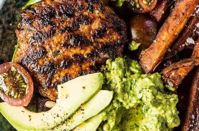 SAVE FOR LATER! Chili Chicken Burger Bowls are everything you love about burgers but served as a bowl. The chicken burger patties are super easy to make and so flavorful. They are grilled or cooked in a pan then served on a bed of lettuce with sweet potato fries and some delicious avocado pesto. You will LOVE them!   gluten-free + paleo + Whole30   #theendlessmeal #burgers #chicken #whole30 #paleo #glutenfree #chickenburgers #dinnerbowls #bowls