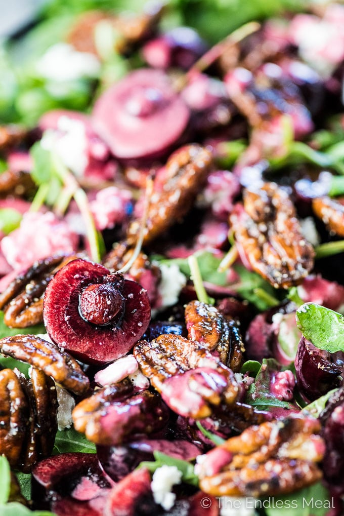 A close up of the fresh cherry salad with lots of candied pecans and cherries.