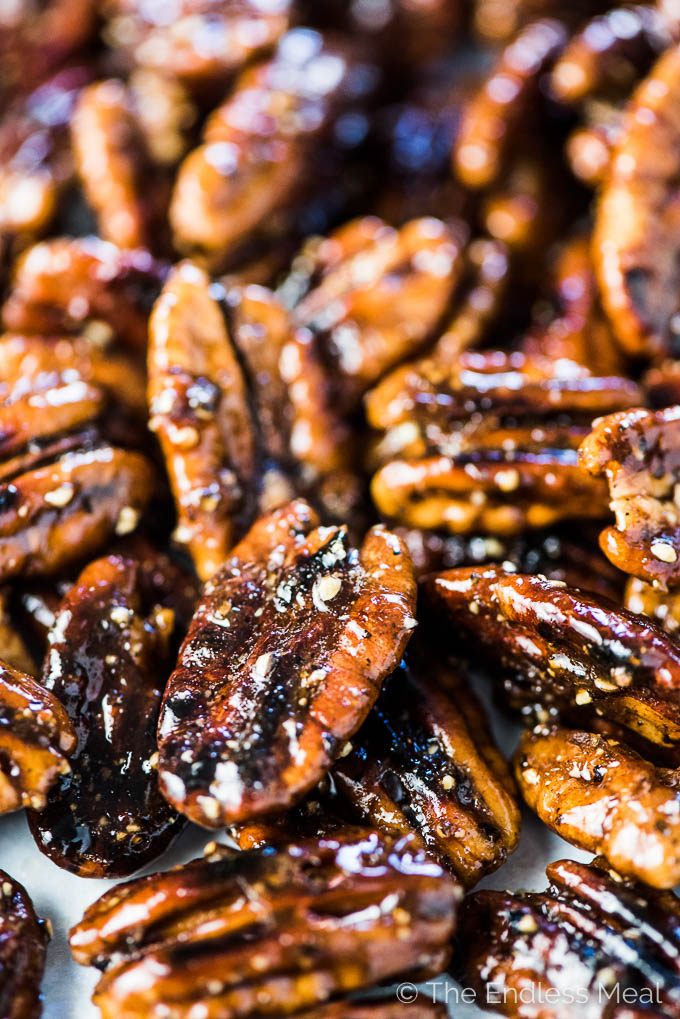 A close up picture of the black pepper candied pecans before they are tossed in the cherry salad.