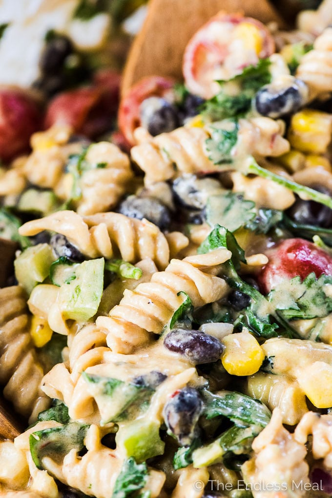 SAVE FOR LATER! This Mexican Pasta Salad recipe is the best ever. It's loaded with creamy avocados, sweet corn, black beans, crunchy green peppers and red onions, and my favorite healthy pasta, @ChickapeaPasta. Then it's smothered in a creamy (and easily vegan!) chipotle lime dressing. You will LOVE it! | gluten-free + vegan | #theendlessmeal #glutenfree #lentilpasta #chickapeapasta #protein #organic #vegan #pasta #pastasalad #mexican #southwest #healthyrecipes #chipotle