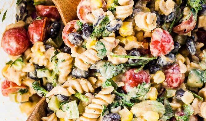 SAVE FOR LATER! This Mexican Pasta Salad recipe is the best ever. It's loaded with creamy avocados, sweet corn, black beans, crunchy green peppers and red onions, and my favorite healthy pasta, @ChickapeaPasta. Then it's smothered in a creamy (and easily vegan!) chipotle lime dressing. You will LOVE it!   gluten-free + vegan   #theendlessmeal #glutenfree #lentilpasta #chickapeapasta #protein #organic #vegan #pasta #pastasalad #mexican #southwest #healthyrecipes #chipotle