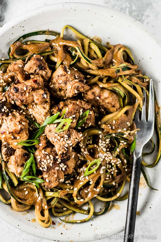 Spicy Sesame Chicken Zoodles are easy to make and so delicious. The creamy tahini-based sesame sauce does double duty as the marinade in this 20-minute dinner recipe. You will LOVE it! | gluten-free + paleo + Whole30 adaptable | #theendlessmeal #zoodles #sesamenoodles #sesamezoodles #sesamechicken #chicken #noodles #tahini #glutenfree #paleo