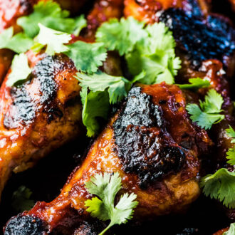SAVE FOR LATER! Korean BBQ Chicken is smothered in an easy to make and DELICIOUS gochujang BBQ sauce then grilled until charred and crispy. This recipe will be your new summer favorite! | dairy-free + easily paleo + gluten-free | #theendlessmeal #chicken #koreanchicken #bbqchicken #gochujang #bbq #barbecue #paleo #glutenfree #dairyfree #summer #korean
