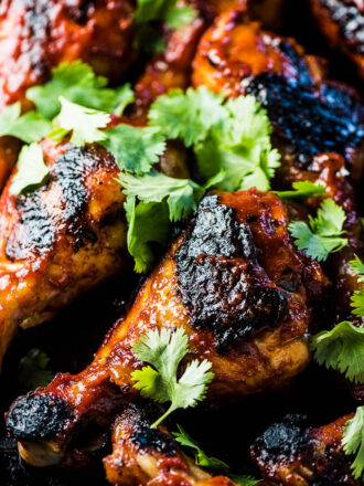 SAVE FOR LATER! Korean BBQ Chicken is smothered in an easy to make and DELICIOUS gochujang BBQ sauce then grilled until charred and crispy. This recipe will be your new summer favorite!   dairy-free + easily paleo + gluten-free   #theendlessmeal #chicken #koreanchicken #bbqchicken #gochujang #bbq #barbecue #paleo #glutenfree #dairyfree #summer #korean