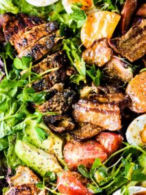 The grilled chicken cobb salad with bacon vinaigrette on a platter.