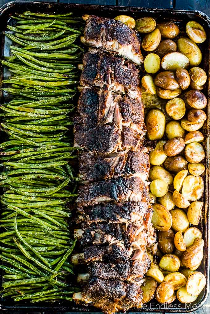 Oven Baked Ribs with green beans on one side and potatoes on the other.