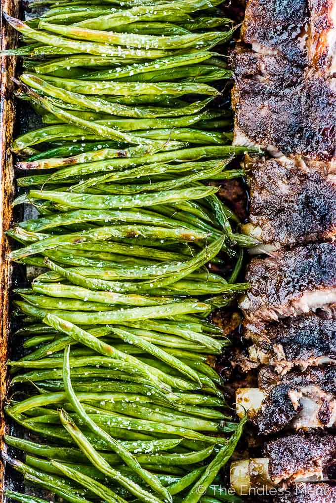 Green beans beside the Oven Baked Ribs.