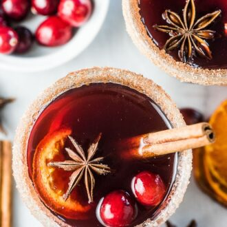 Looking down on two glasses of cranberry hot toddy.