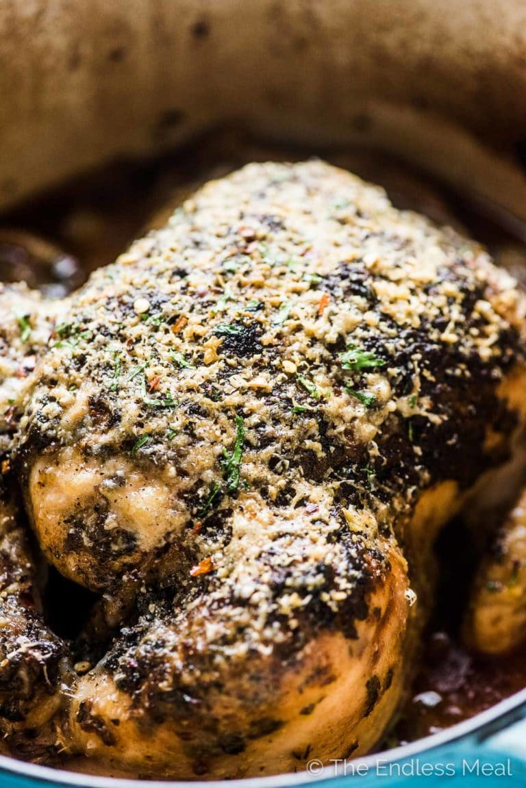 Roasted Parmesan Crusted Chicken in a pot with a closeup of the crispy skin.