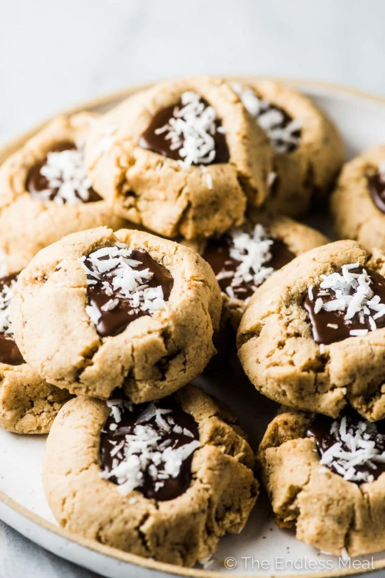 A plate of Chocolate Almond Thumbprint Cookies.