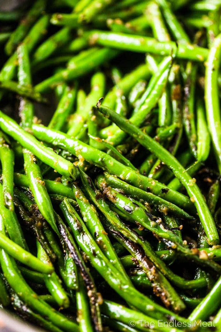A close up of sauteed string beans