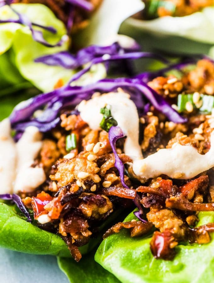 A close up of this turkey lettuce wraps recipe with tahini sauce drizzled over the top.