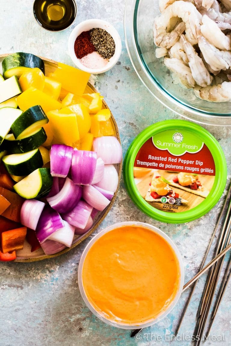 All the veggies and shrimp to make this grilled shrimp skewers recipe with a container of Summer Fresh Roasted Red Pepper Dip.