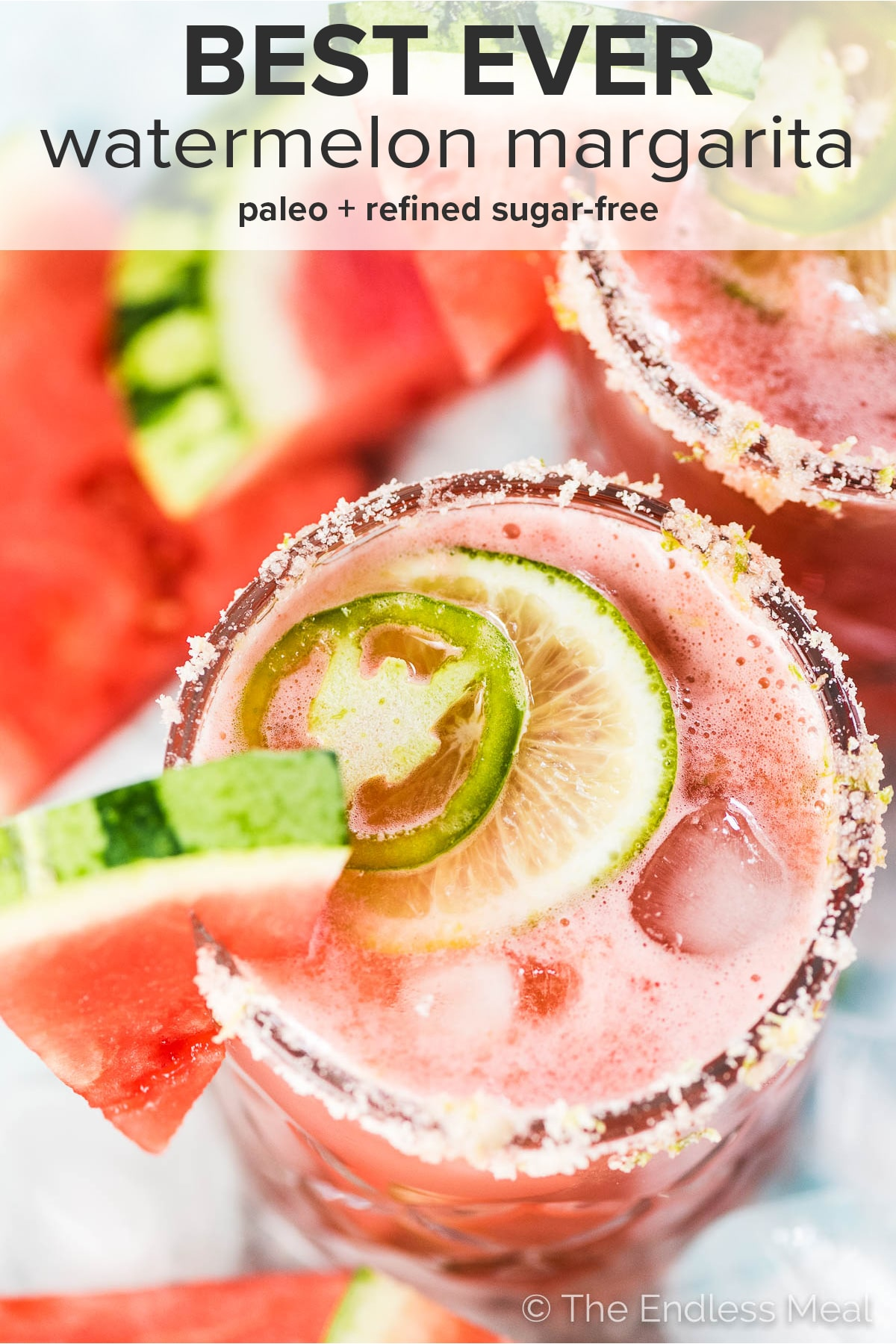 A pink watermelon margarita with the recipe title at the top of the picture.