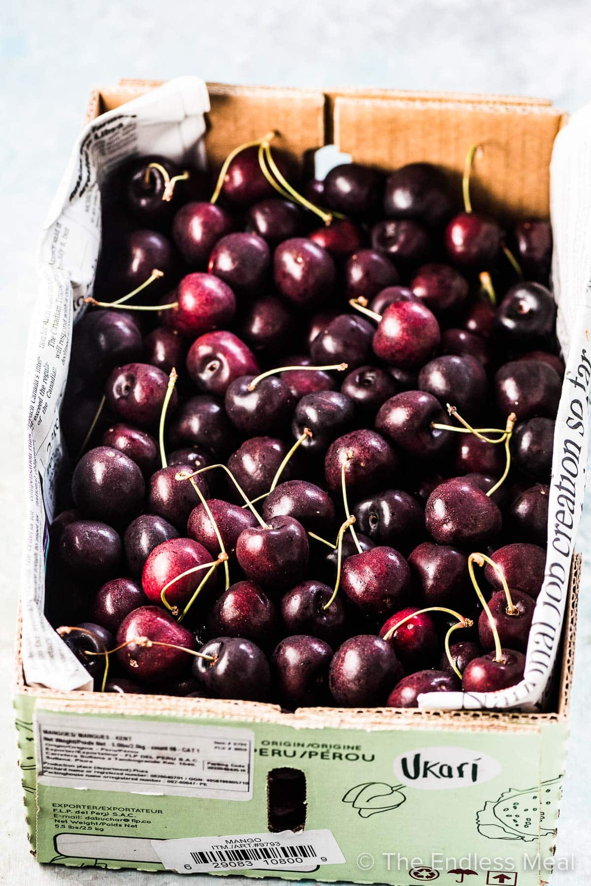 Fresh cherries in a box ready to be made into cherry compote.
