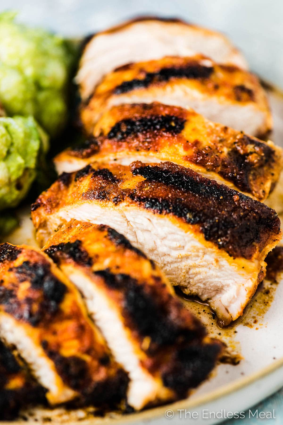 A close up of a slice of juicy grilled chicken breast.