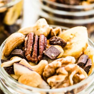 Homemade trail mix in glass jars.