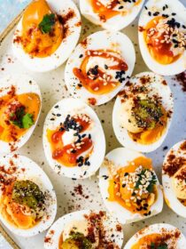 A plate of easy deviled eggs made three different ways.