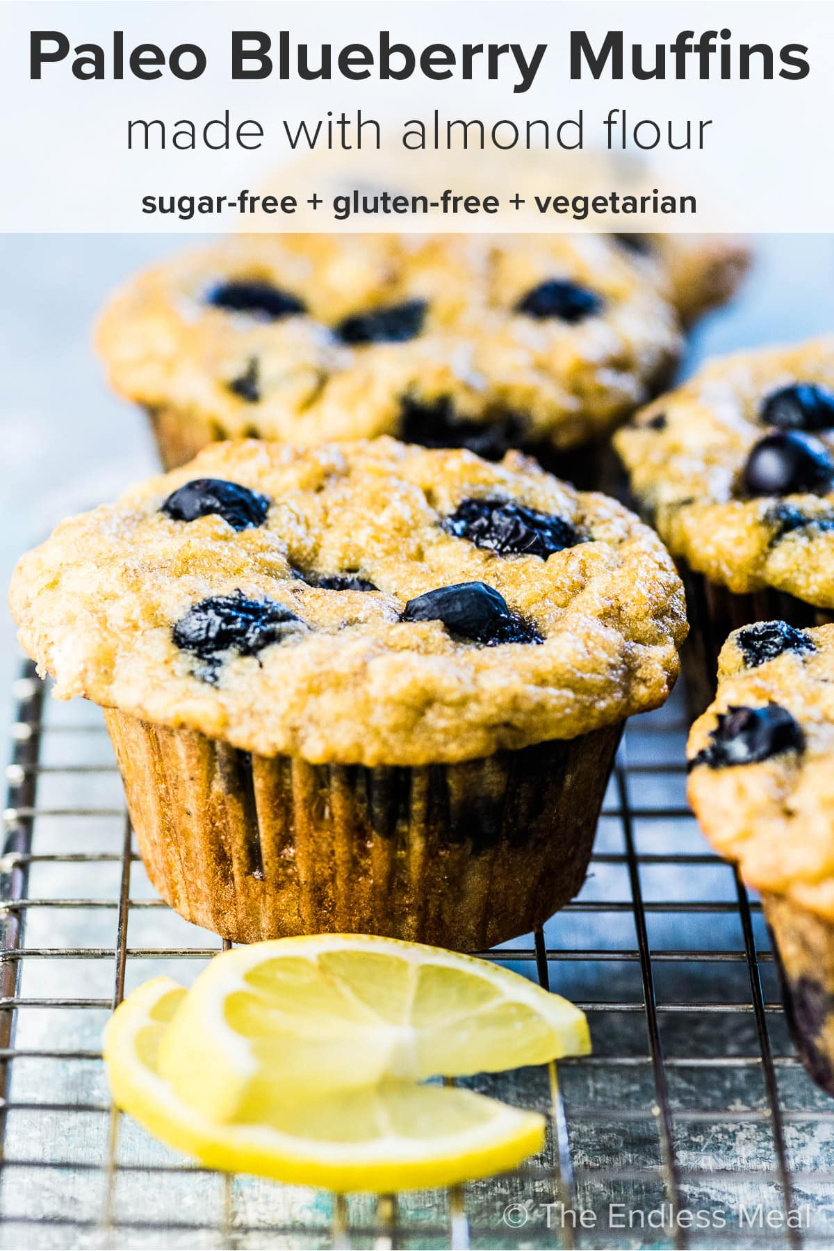 Paleo blueberry muffins with the recipe title on top of the picture.