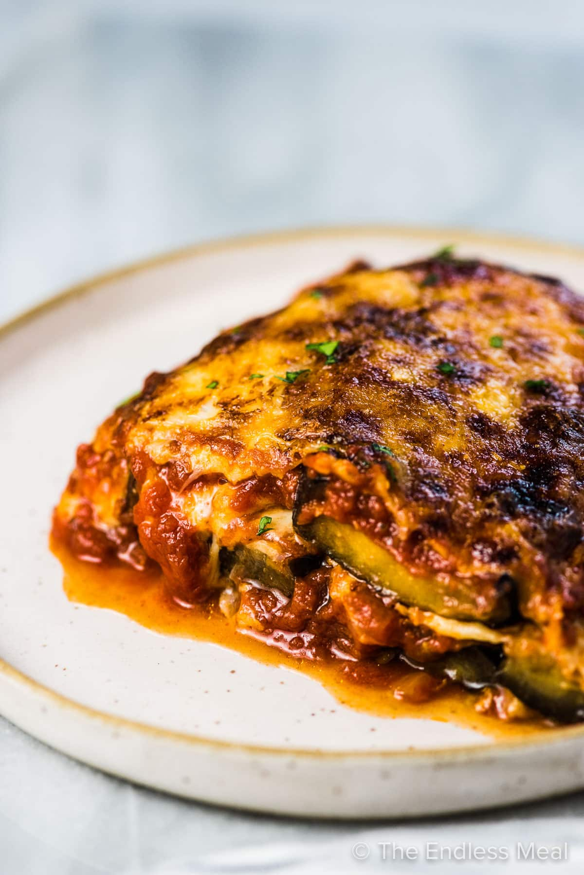 Side view of the layers of eggplant parmesan.