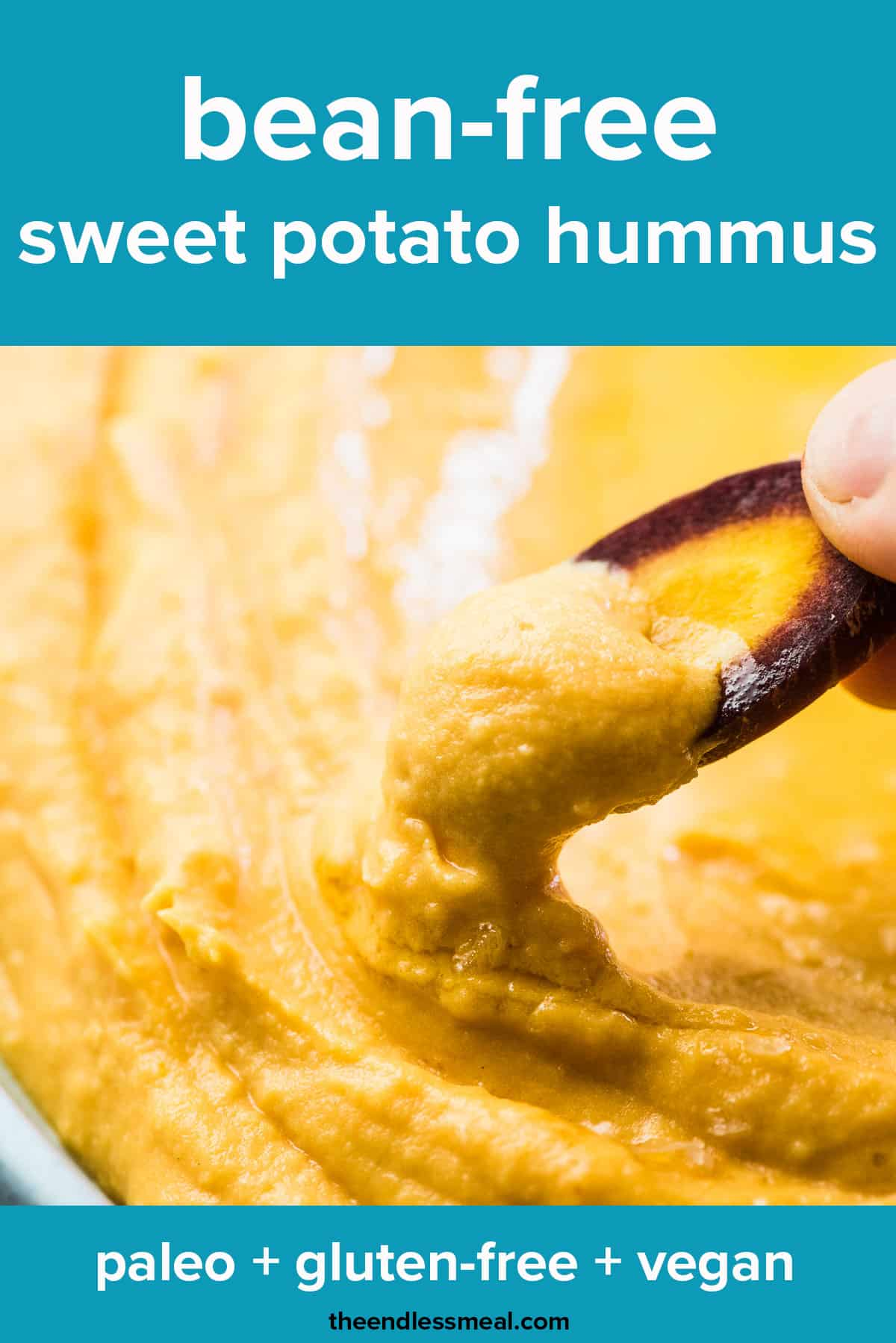 A carrot stick scooping up some sweet potato hummus with the recipe title on top of the picture.