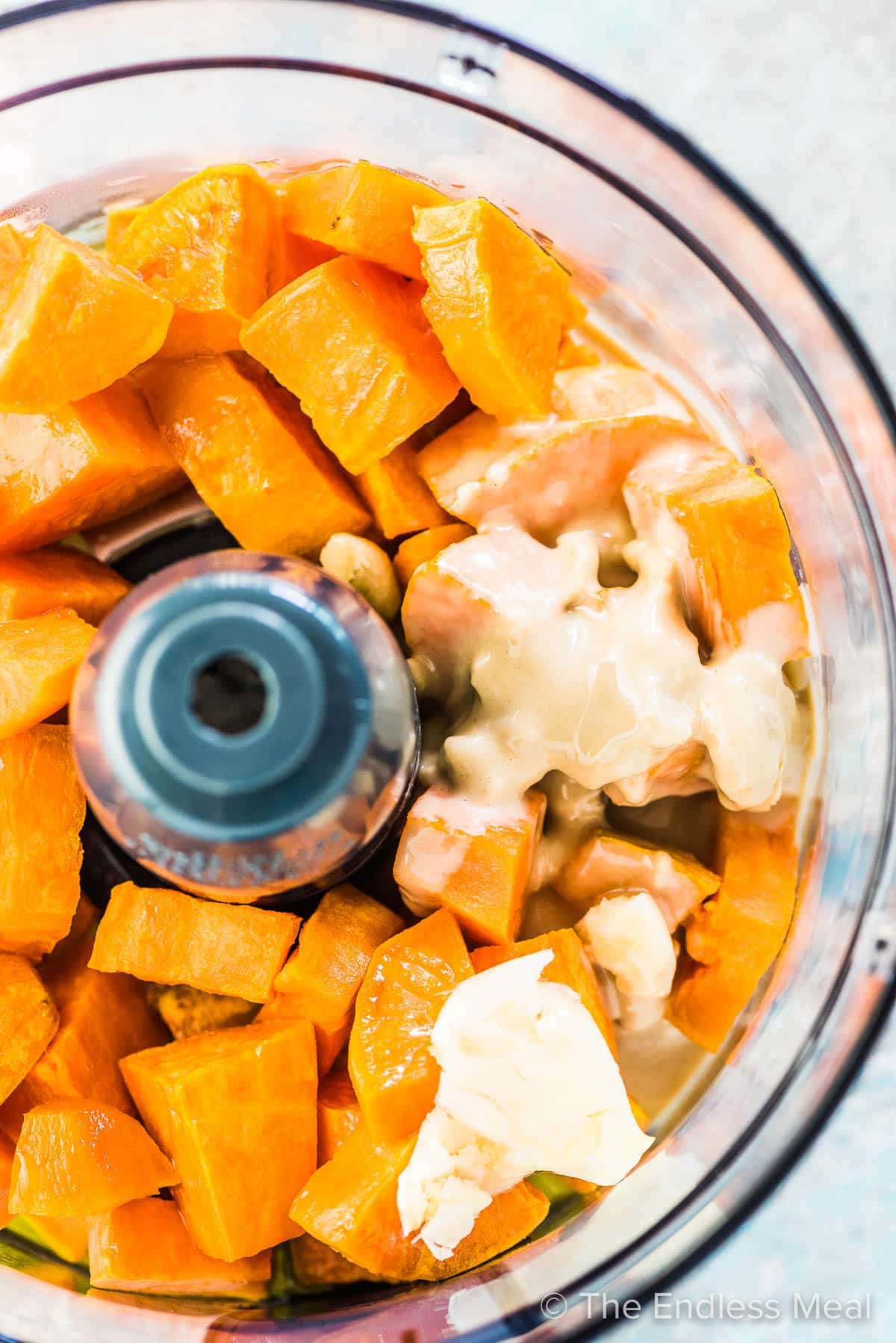 All the ingredients for this sweet potato hummus in a food processor.