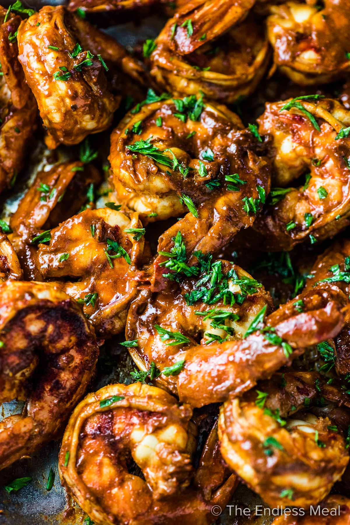 A closeup of chili lime shrimp in a pan.