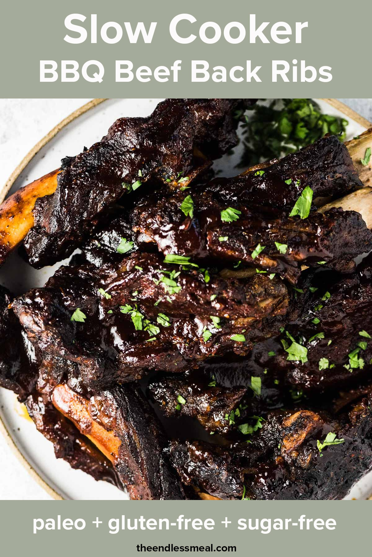 BBQ beef ribs on a plate with the recipe title on top of the picture.