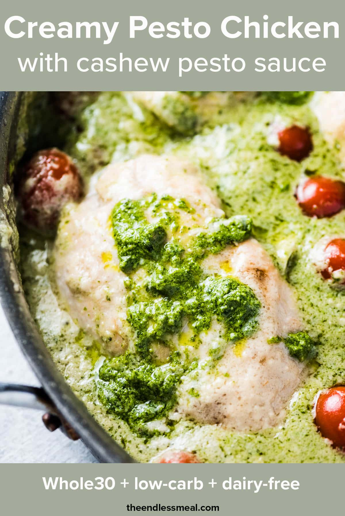 A close up of creamy pesto chicken in a cashew pesto sauce with the recipe title on top of the picture.