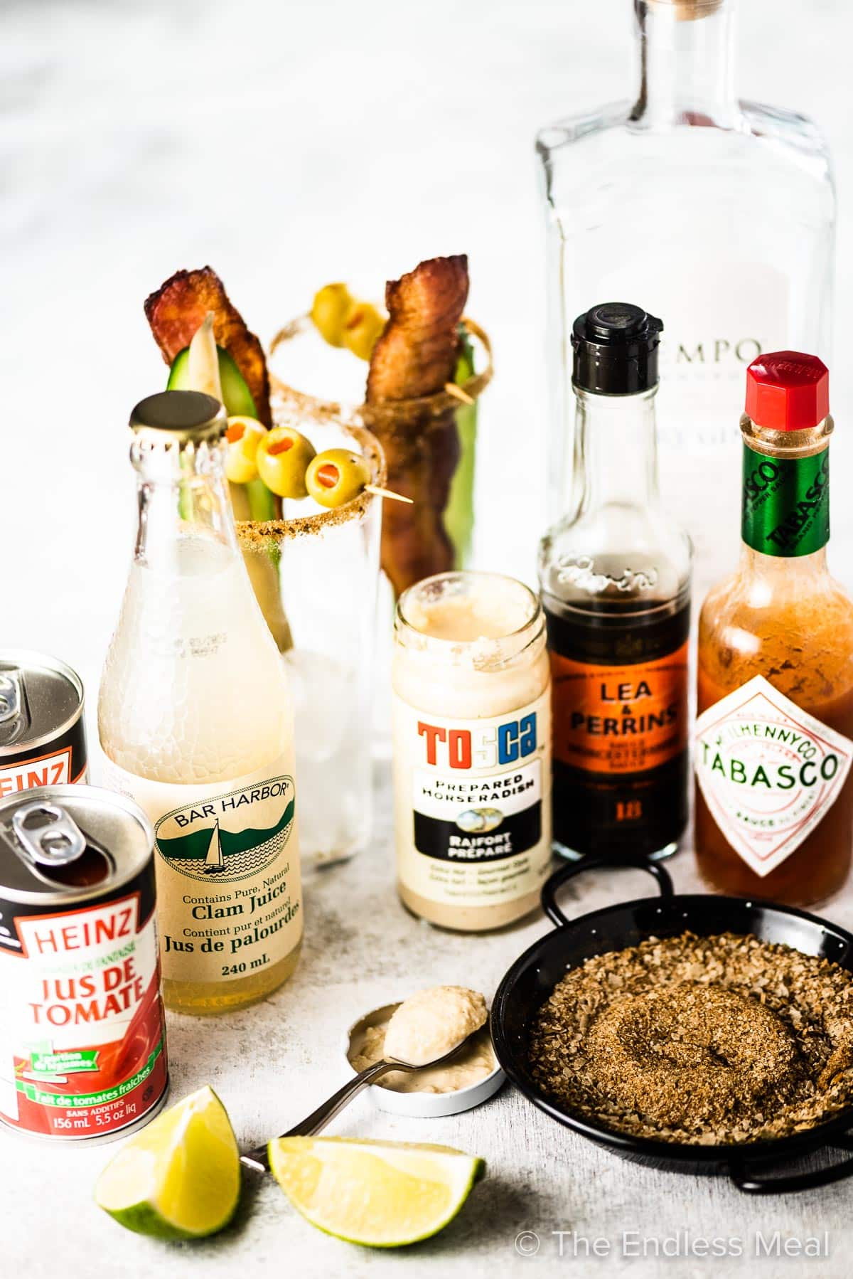 All the ingredients to make the best Bloody Caesar cocktail.